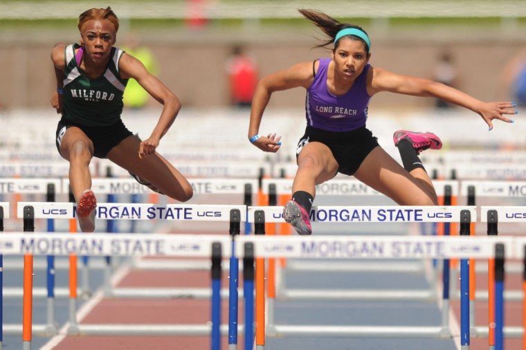 Milford Mill's Medinah Spencer, left, and Long Reach's Taylor Selber clear a hurdle, nearly in sync, in the 3A girls 100 hurdles during the 2014 track and field state championships at Morgan State University. The two finished first and second, respectively. (Brian Krista/BSMG)