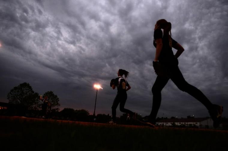 Mt. Hebron players run across the field at the state semifinal softball game between Mt. Hebron and Linganore. (Matt Hazlett/BSMG)