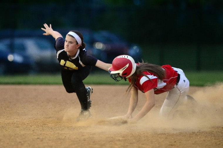 Mt. Hebron's Rachel Cadigan, left, misses the tag while Linganore's Alex Bullard slides safely into second base. State semifinal softball game between Mt. Hebron and Linganore. (Matt Hazlett/BSMG)