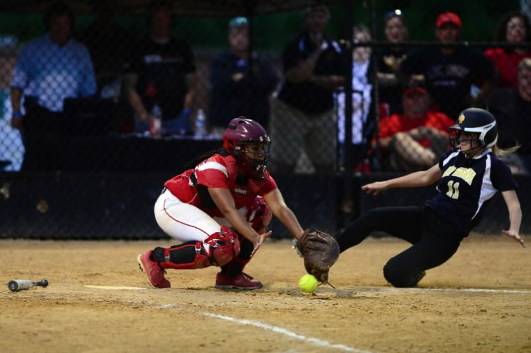 Mt. Hebron's Kelsey Albert, right, slides safely into home plate past Linganore's Madison Ambush during the state semifinal softball game between Mt. Hebron and Linganore. (Matt Hazlett/BSMG)