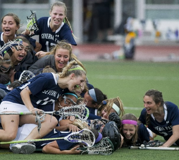 Severna Park players celebrate after winning the MPSSAA 3A/4A girls lacrosse championship game between Severna Park and Catonsville at the UMBC Stadium on May 21, 2014. (Scott Serio/BSMG)