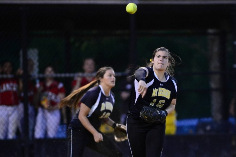 M.t Hebron's Eevie Buehlman makes the throw to first base during the state semifinal softball game between Mt. Hebron and Linganore. (Matt Hazlett/BSMG)