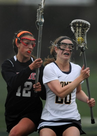 Catonsville's Chloe Corbitt, right, controls the ball while pressured with tight coverage by Dulaney's Emma O'Grady during a girls lacrosse game at Catonsville High School. (Brian Krista/BSMG)
