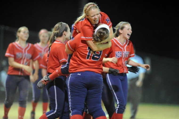 Northern-Calvert's Allison Garzone leaps into the arms of her teammate, Sarah Bennett, as they celebrate their 3-2 victory in walk-off fashion in the bottom of the seventh inning during the Class 3A state semifinal softball game at Bachman Sports Complex in Glen Burnie on Tuesday, May 20. (Brian Krista/BSMG)