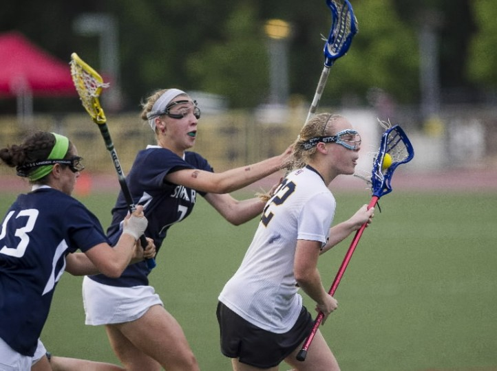 Catonsville's Lauren McDonald drives past Severna Park's Julianna Ricci and Eva Klaus to take a shot and score during the MPSSAA 3A/4A girls lacrosse championship game between Severna Park and Catonsville at the UMBC Stadium in Catonsville on May 21, 2014. (Scott Serio/BSMG)