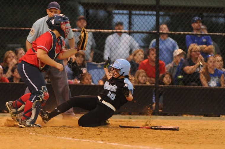 C. Milton Wright's Rachel Knoebel slides safely past Northern-Calvert catcher Sarah Bennett scoring on a two-run double by teammate Jenny Lynch during the Class 3A state semifinal softball game at Bachman Sports Complex in Glen Burnie on Tuesday, May 20. (Brian Krista/BSMG)