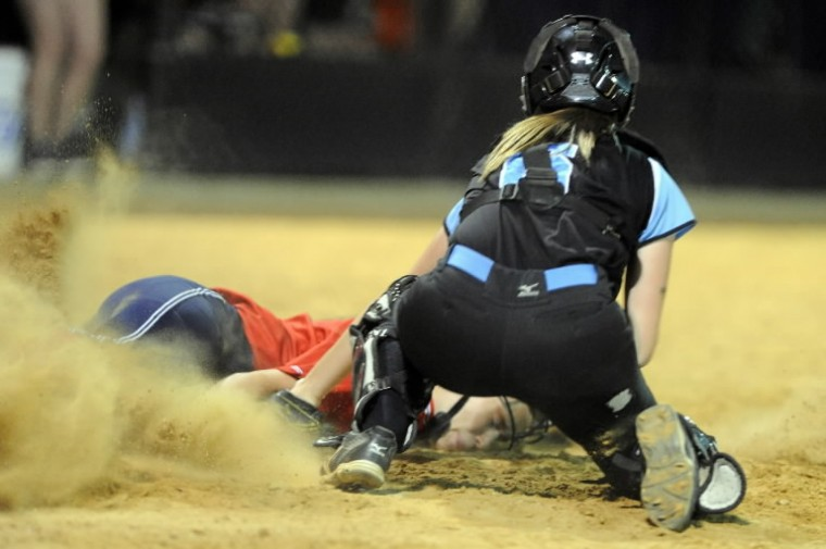 C. Milton Wright catcher Emily Luzetsky tags out Northern-Calvert runner Holly Van Wie as she hits the dirt on a play at the plate during the Class 3A state semifinal softball game at Bachman Sports Complex. (Brian Krista/BSMG)