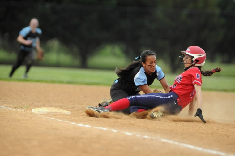 C. Milton Wright's Catherine Kim tags out Northern-Calvert runner Lisa Seifert on a play at third base during the Class 3A state semifinal softball game at Bachman Sports Complex in Glen Burnie on Tuesday, May 20. (Brian Krista/BSMG)