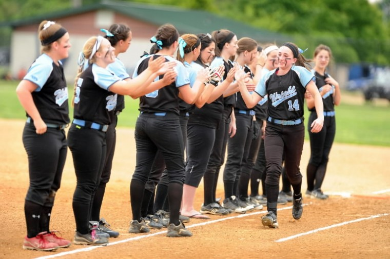 C. Milton Wright's Kyralee Comeaux slaps hands with teammate during player introductions against Northern-Calvert during the Class 3A state semifinal softball game at Bachman Sports Complex in Glen Burnie on Tuesday, May 20. (Brian Krista/BSMG)