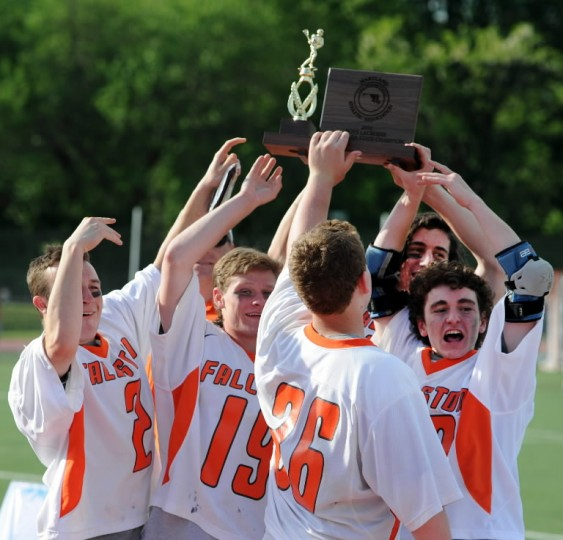 Members of the Fallston boys lacrosse team hold the state championship trophy high after Tuesday's win over North Carroll in the Class 2A-1A state championship game at UMBC. (Matt Button/BSMG)