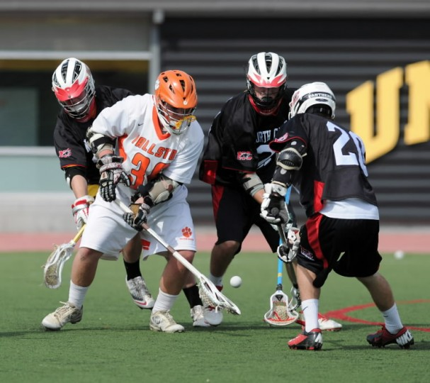 Fallston's Brenden Nolan battles a few North Carroll players as they go for the ground ball during Tuesday's Class 2A-1A state championship game at UMBC. (Matt Button/BSMG)