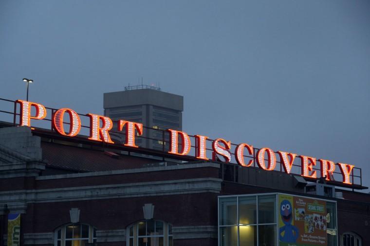 The sign for the children's museum at dusk in 2014. (Karl Merton Ferron/Baltimore Sun)