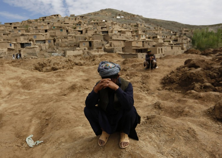 Afghan survivors mourn for their relatives at the site of a landslide at the Argo district in Badakhshan province May 5, 2014. Grief-stricken and desititute Afghan villagers vented anger with their government as they scrambled for emergency aid, three days after deadly landslides engulfed their homes. Some 300 homes in Aab Bareek, a village in the Argo district of Badakhshan, a remote and mountainous northeastern province, were buried under up to 50 metres of earth and debris. (Mohammad Ismail/Reuters)