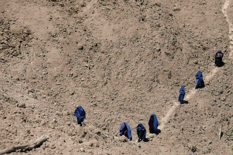 Afghan women arrive at the site of a landslide, after the dead body of a woman was found, at the Argo district in Badakhshan province. (Mohammad Ismail/Reuters)