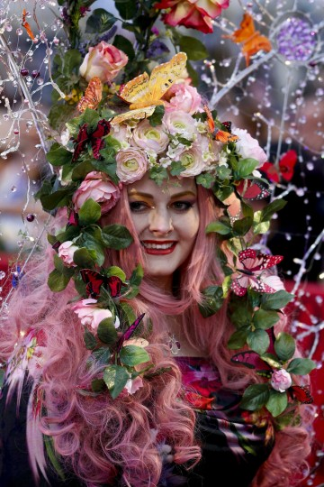 A guest arrives for the opening ceremony of the 22nd Life Ball in Vienna. Life Ball is Europe's largest annual AIDS charity event and takes place in Vienna's city hall. (Leonhard Foeger/Reuters)