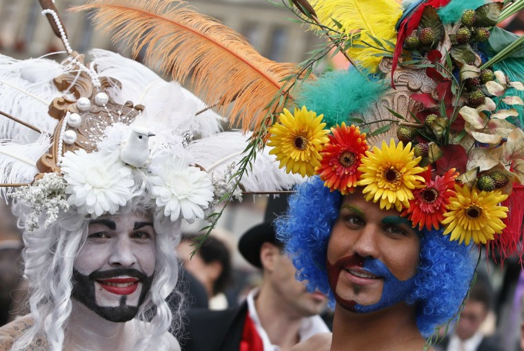 Guests arrive for the opening ceremony of the 22nd Life Ball in Vienna May 31, 2014. Life Ball is Europe's largest annual AIDS charity event and takes place in Vienna's city hall. (Leonhard Foeger/Reuters)
