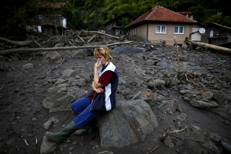 Fata Kovacevic reacts near her flood-damaged house in Topcic Polje. At least 40 people have died in Serbia, Bosnia and Croatia, after days of the heaviest rainfall since records began 120 years ago caused rivers to burst their banks and triggered hundreds of landslides. (Dado Ruvic/Reuters)