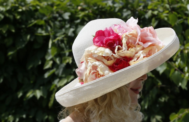 A woman wears a flower-decorated hat during media day at the Chelsea Flower Show in London May 19, 2014. (Stefan Wermuth/Reuters)