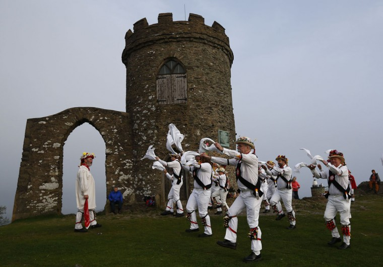Leicester Morris Men dance at Bradgate Park in Newtown Linford, central England May 1, 2014. The May Day Morris celebration is a traditional rite thought to be connected to changing seasons and fertility. (REUTERS/Darren Staples)
