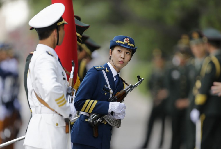 A female member of the honour guard looks on ahead of a welcoming ceremony for Malaysia's Prime Minister Najib Razak outside the Great Hall of the People, in Beijing, May 29, 2014. REUTERS/Jason Lee