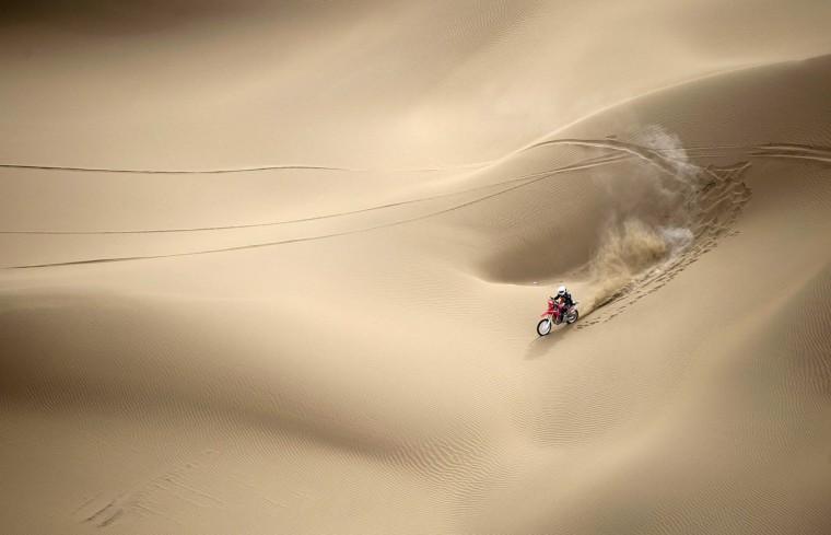 Wang Yirong of Hebei province rides his motorcycle in a desert during the China Taklimakan Rally and CCR Xinjiang Station, in Shanshan, Xinjiang Uighur Autonomous Region. (China Daily/via Reuters)