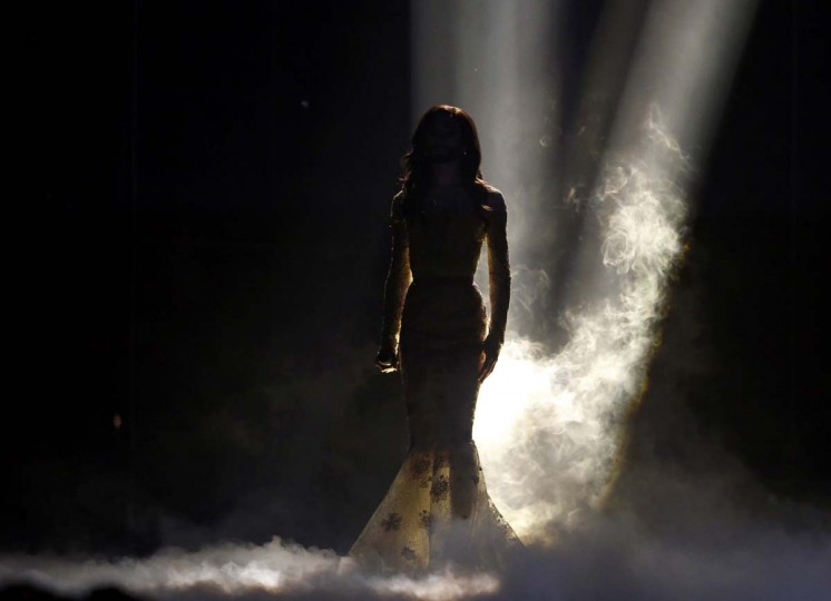 """Conchita Wurst representing Austria performs the song """"Rise Like a Phoenix"""" during the grand final of the 59th Eurovision Song Contest at the B&W Hallerne in Copenhagen May 10, 2014. REUTERS/Tobias Schwarz"""