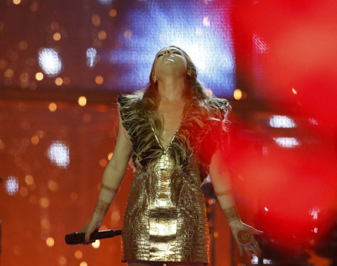 """Singer Molly representing United Kingdom performs the song """"Children of the Universe"""" during the grand final of the 59th Eurovision Song Contest at the B&W Hallerne in Copenhagen May 10, 2014. REUTERS/Tobias Schwarz"""