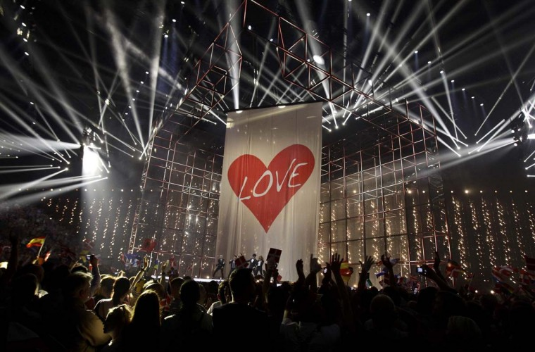"""Singer Basim representing Denmark performs the song """"Cliche Love Song"""" during the grand final of the 59th Eurovision Song Contest at the B&W Hallerne in Copenhagen May 10, 2014. REUTERS/Tobias Schwarz"""
