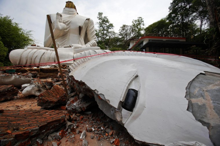 A Buddha statue, damaged by an earthquake, is seen at the Udomwaree temple in Chiang Rai, in northern Thailand. An earthquake of 6 magnitude struck northern Thailand on Monday causing some damage to buildings and roads and knocking goods off shelves in shops but there were no immediate reports of any casualties. (Athit Perawongmetha/Reuters)