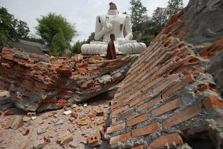 A Buddhist monk walks in front of a Buddha statue damaged in the earthquake at the Udomwaree temple in Chiang Rai, in northern Thailand. An earthquake of 6 magnitude struck northern Thailand on Monday causing some damage to buildings and roads and knocking goods off shelves in shops but there were no immediate reports of any casualties. (Athit Perawongmetha/Reuters)