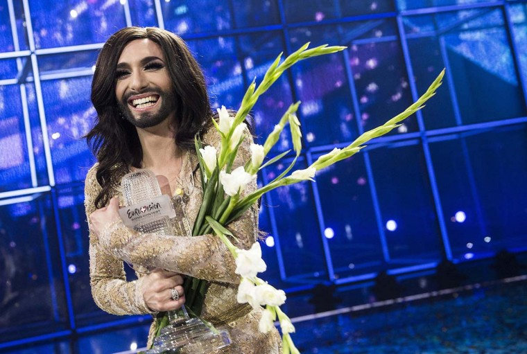 """Conchita Wurst representing Austria poses with the trophy after winning the 59th annual Eurovision Song Contest (ESC) at the B&W Hallerne in Copenhagen, in this May 10, 2014 picture provided by Scanpix Denmark. Wurst, popularly known as """"the bearded lady,"""" won the ESC on Saturday with the James Bond-theme-like ballad """"Rise Like a Phoenix"""", before a global TV audience of about 180 million people in 45 countries. Picture taken May 10. REUTERS/Mogens Flindt"""