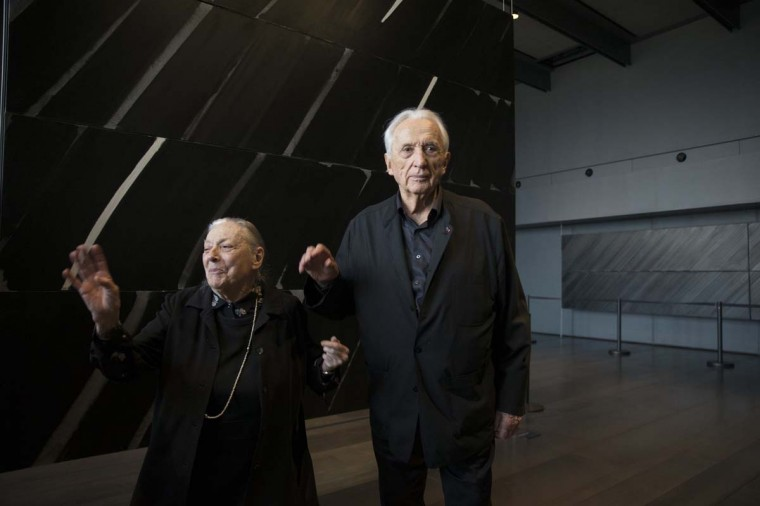 French painter Pierre Soulages and his wife Colette pose amongst Soulages' paintings after the inauguration of the Soulages Museum in Rodez, southwestern France, May 30.  || PHOTO CREDIT: PHILIPPE WOJAZER  - REUTERS