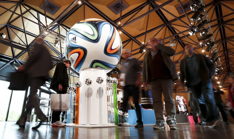 Shareholders of Adidas, the world's second largest sports apparel firm, arrive for the company annual general meeting in the northern Bavarian town of Fuerth near Nuremberg May 8, 2014. (REUTERS/Michaela Rehle)