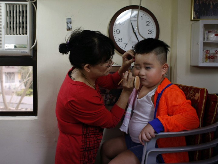 Rex Chan, 5, receives make up before taking part in a Bun Festival parade at Hong Kong's Cheung Chau island. The festival celebrates the islanders' deliverance from famine many centuries ago and is meant to placate ghosts and restless spirits. (Bobby Yip/Reuters)