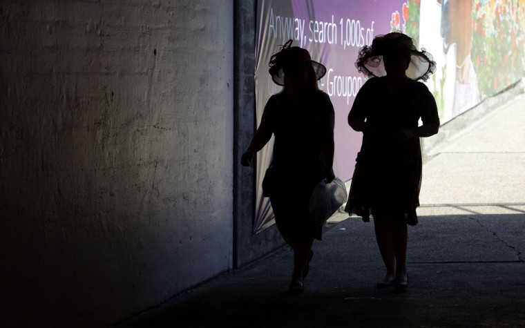 Patrons make their way to the infield through a tunnel before the 2014 Kentucky Derby at Churchill Downs. (Jamie Rhodes-USA TODAY Sports)