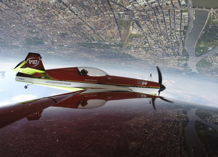 Zoltan Veres of Hungary performs with his MXS airplane during an air show in Budapest, May 1, 2014. (REUTERS/Laszlo Balogh)