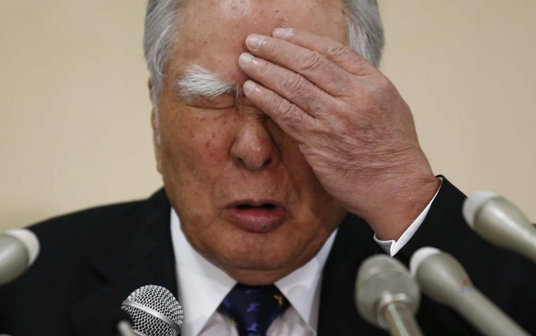Suzuki Motor Corp Chairman and Chief Executive Osamu Suzuki reacts during a news conference on the company's financial results in Tokyo May 9.  || PHOTO CREDIT: TORU HANAI - REUTERS