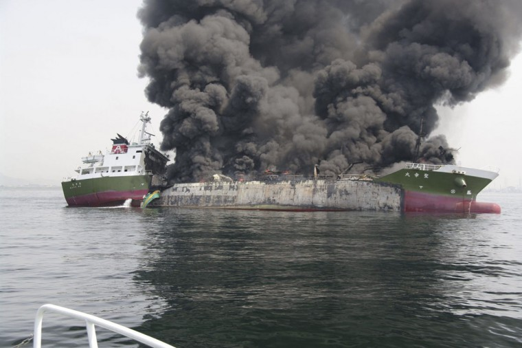 Smoke rises from the 998-tonne fuel tanker Shoko Maru after it exploded off the coast of Himeji, western Japan, in this photo taken and released by the 5th Regional Coast Guard Headquarters - Japan Coast Guard May 29, 2014. The fuel tanker captain is missing and four crew members have sustained severe injuries following the explosion aboard the vessel off Himeji, in western Japan, Kyodo news reported. REUTERS/5th Regional Coast Guard Headquarters - Japan Coast Guard/Handout via Reuters