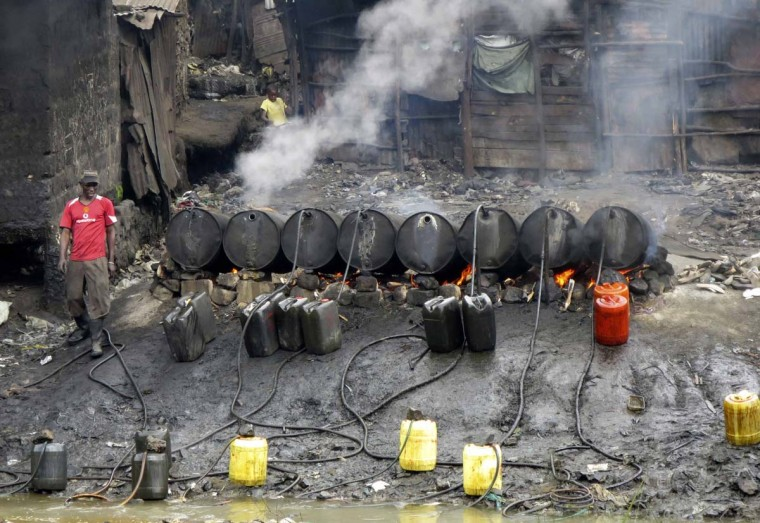 "A labourer prepares distilled traditional brewed alcoholic liquor, locally known as ""chang'aa"", at an illegal micro-brewery along a river in the suburbs of Kenya's capital Nairobi May 9. Eighty people have died after drinking from a batch of illegal liquor in Kenya, and police have detained several people for questioning, officials and police said on Wednesday. Consumption of illicit alcohol is common in Kenya, where many cannot afford factory-made beers and spirits. Deaths often occur but this is the largest number of people killed in a single incident for several years.    