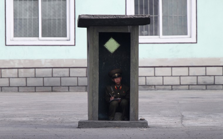 A North Korean soldier sits inside a sentry post as he guards on the banks of the Yalu River near the North Korean town of Sinuiju, opposite the Chinese border city of Dandong, May 4, 2014. Picture taken May 4, 2014. (Jacky Chen/Reuters)