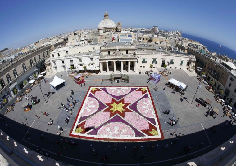 A 400-square-metre (4305-square-feet) infiorata, a carpet of flowers made up of some 80,000 potted plants, is seen at St George's Square in Valletta May 9. The Valletta 2018 Foundation is holding the first edition of the Valletta Green Festival, an event intended to raise environmental consciousness as part of Valletta's development toward becoming the European Capital of Culture in 2018.  Picture taken with a fisheye lens.       || PHOTO CREDIT: DARRIN ZAMMIT LUPI  - REUTERS