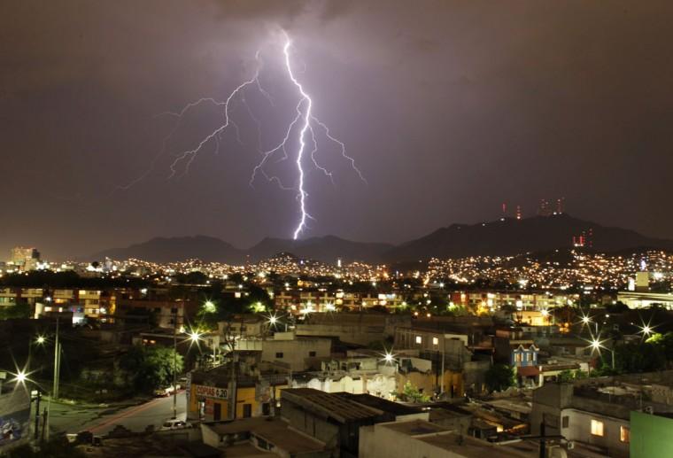 Lightning illuminates the sky over downtown Monterrey May 28, 2014. REUTERS/Daniel Becerril