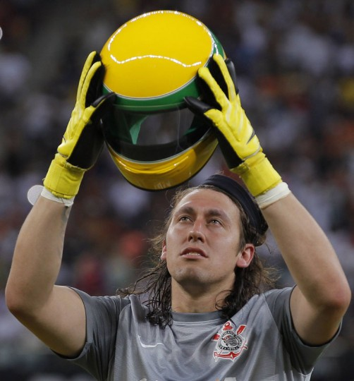 Goalkeeper Cassio Ramos of the Corinthians soccer club holds a replica of the helmet worn by late Brazilian Formula One driver Ayrton Senna before the start of their Copa do Brasil match against rival club Nacional AM in the Arena Amazonas stadium in Manaus, April 30, 2014. The Corinthians paid tribute to Senna on the eve of the 20th anniversary of his death during an F1 race in Imola, Italy. (REUTERS/Bruno Kelly0