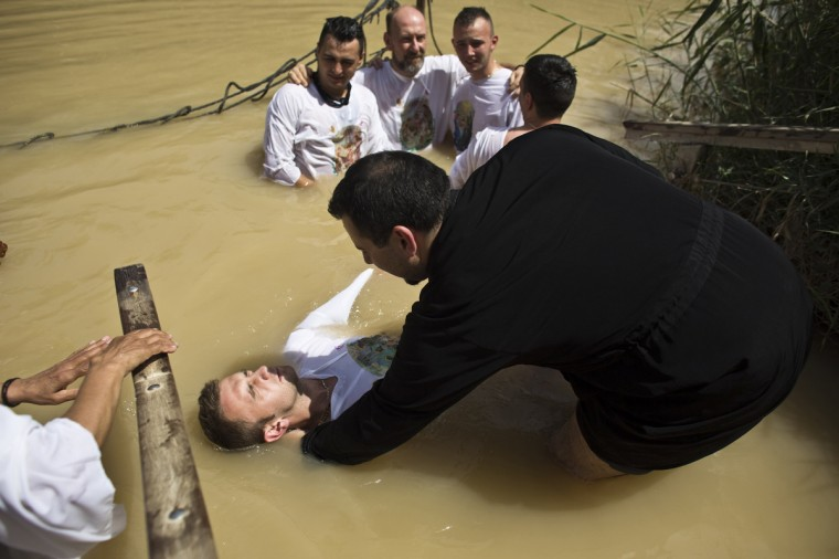 Christian pilgrims dip in the water at the baptismal site known as Qasr el-Yahud on the banks of the Jordan River near the West Bank city of Jericho. Pope Francis will visit the Jordanian side of the baptismal site, known as Bethany Beyond the Jordan, situated on the east bank of the Jordan River and believed to be where Jesus was baptised, during this visit to the region next week, where he will travel to Jordan, Palestinian Territories and Israel between May 24-26. (Nir Elias/Reuters)