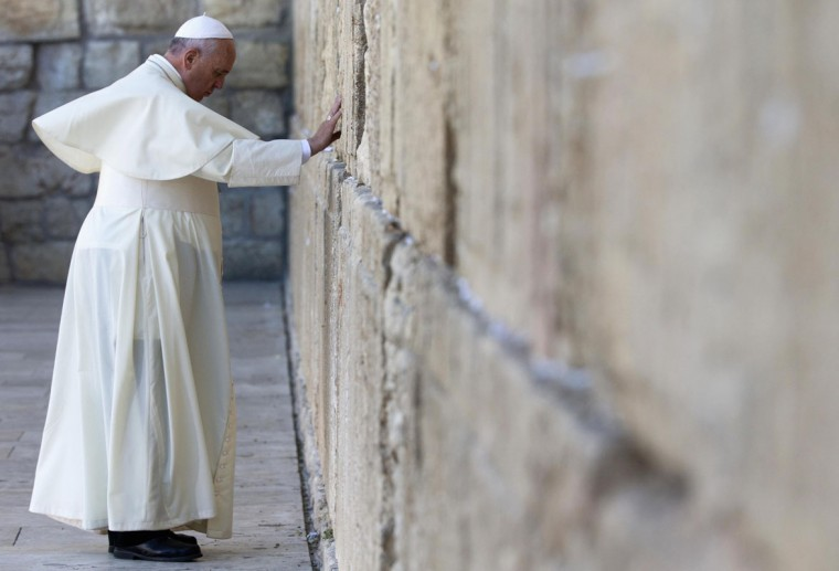Pope Francis touches the stones of the Western Wall, Judaism's holiest prayer site, in Jerusalem's Old City May 26, 2014. Francis completes a tour of the Holy Land on Monday, paying homage to Jews killed in the Nazi Holocaust and looking to affirm Christian rights at a disputed place of worship in Jerusalem. (REUTERS/Andrew Medichini/Pool)