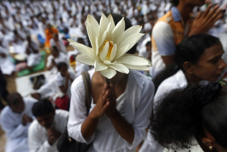 A Buddhist devotee worships at Kelaniya temple in Colombo on Vesak Day. Vesak Day, which is celebrated on May 14 and 15 in Sri Lanka, commemorates the birth, enlightenment and death of Buddha. (Dinuka Liyanawatte/Reuters)