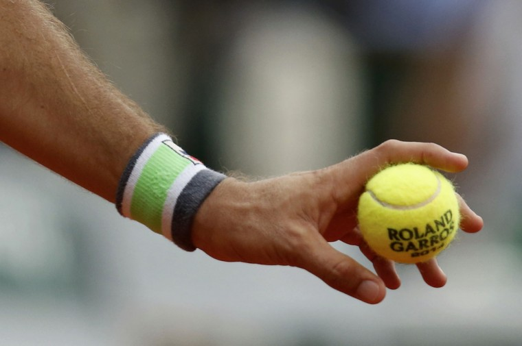 A close up shows the hand of Carlos Berlocq of Argentina holding a ball during his men's singles match against Richard Gasquet of France at the French Open tennis tournament at the Roland Garros stadium in Paris May 29, 2014. REUTERS/Jean-Paul Pelissier