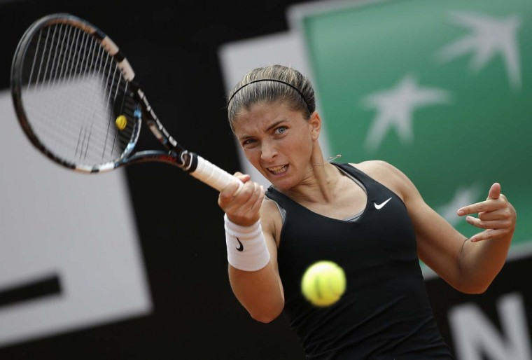 Sara Errani of Italy hits a return to Chanelle Scheepers of South Africa during their women's singles match at the Rome Masters tennis tournament May 13, 2014. (Max Rossi/Reuters)
