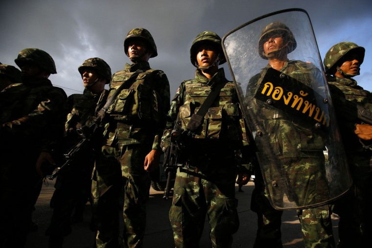 Thai soldiers stand guard during a coup at the Army Club where Thailand's army chief held a meeting with all rival factions in central Bangkok May 22, 2014. Thailand's army chief General Prayuth Chan-ocha took control of the government in the coup on Thursday saying the army had to restore order and push through reforms, two days after he declared martial law. REUTERS/Athit Perawongmetha