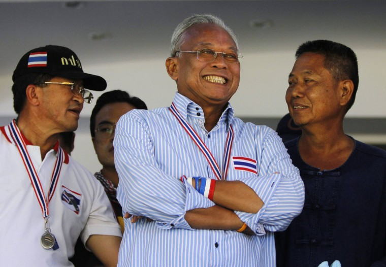 Anti-government protest leader Suthep Thaugsuban smiles during a rally at the Air Force base in Bangkok May 15, 2014. (REUTERS/Chaiwat Subprasom)